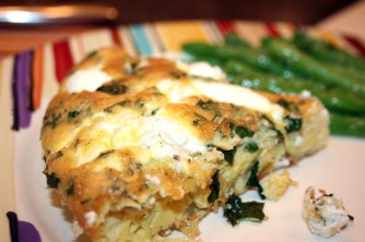 Close up of a piece of the Onion and Goat Cheese Frittata and the Lemon Dijon Green Beans