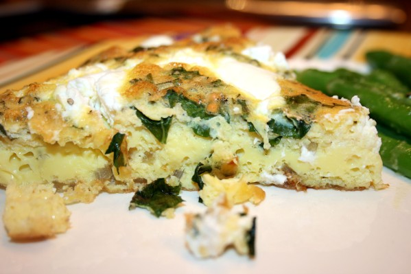 Close up of a piece of the Onion and Goat Cheese Frittata